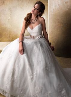 "Designer: Maggie Sottero ""Jayla""    Description: Breathtaking tulle and sequin ball gown with lace appliqués, spaghetti straps and sweetheart neckline. Includes detachable grosgrain belt featuring handmade flowers and a lace motif. Finished with zipper over inner corset and button closure.    $1549.00"