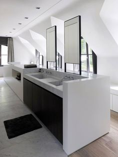 Bathroom by Obumex.  ~~  idea for  dormer baths; put seating/storage in low part