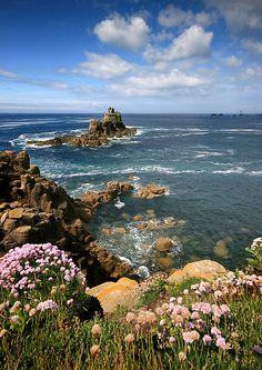 The rugged and rocky coastline of Lands End, Cornwal, looking out towards the lighthouse and rocks known as the Long Ships.