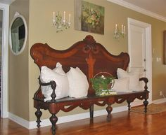 This is a great idea of turning an antique headboard into a lovely bench.