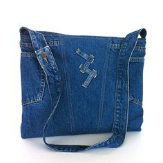 This gives me an idea, the little strips could hold something, like a pen, or a key attached with a ring... - - - Cross body purse recycled blue jean messenger bag by Sisoibags 1 of 2