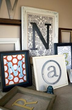 This is a possibility for either the family room or bathroom. Walnut frame, blue & white fabric, green letter.