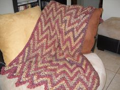 Crocheted afghan made from homespun yarn, its so soft.