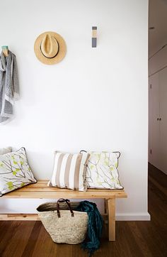 """In the entrance, Dianne made the painted timber wall hooks above the [Ikea](http://www.ikea.com/?utm_campaign=supplier/ target=""""_blank"""") bench seat.: [object Object]"""