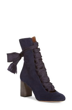 Bold webbing laces wind their way up elegant mid-height boots crafted from supple kidskin suede and set atop a chunky, '70s-inspired stacked leather heel.