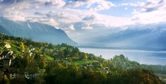 Lake Geneva is one of the largest lakes in Europe. It is located between France and Switzerland by the Rhone river. Lake Geneva Switzerland, Picture Postcards, I Want To Travel, Yoga Retreat, Cool Places To Visit, Beautiful Places, Scenery, Around The Worlds, Consciousness