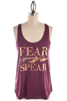 This garnet and gold Judy Tank is a must-have for all Seminole fans! It is a comfy tri-blend (50% Polyester, 25% Cotton, 25% Rayon) racerback and is so soft and form fitting. We recommend ordering a s