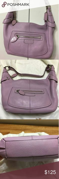Lavender/pink coach Penelope Hobo This is a cute pebbled leather coach hobo bag. It is in good condition but has a small smudge on the back side of the bag. Other than that it was well taken care of. Coach Bags Hobos