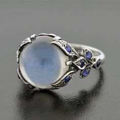 A. Brandt and Son - Vintage Sterling Moonstone Cabochon & Sapphire Ring. http://www.abrandtandson.com/