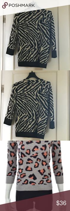 ❤️ Club Monaco animal print sweater size small ❤️ Animal print sweater from the fabulous Club Monaco. Perfect for a night out or to add some flair to the office!  Other photo of different sweater shows the fit of this one.   Size small  Very gently worn   MAKE ME AN OFFER Club Monaco Sweaters Crew & Scoop Necks
