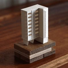 charles young meticulously builds a moving, miniature paper metropolis