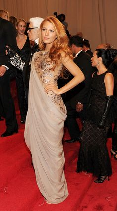 Blake Lively just did everything right on this red carpet, the hair, the makeup, the dress...need I say more? (: