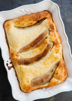 The English classic Toad-in-the-Hole—sausage links baked in a Yorkshire pudding like flour egg batter. Kids love it!