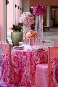 Strings of beads/pearls hanging from tall vases--love it.  Also the ruffles!