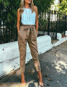 White and caramel high waisted pants is fashion on fleek.