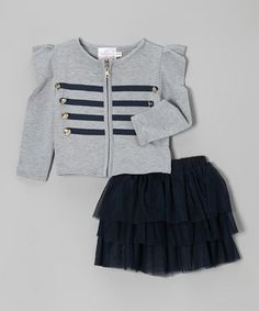 Treat stylish sweeties to a touch of couture charm with this pretty pair. The jacket boasts a military-inspired design with bright buttons and sweet stripes, while the frilly skirt features an elastic waistband for playtime-approved comfort.