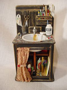 "1"" Scale for Dollhouse 2"" wide x 2"" deep x 4"" tall Black wooden sink decked out to the max inside and out w/ various supplies for an artist. Visit my miniature shop at: marquisminiatures.etsy.com"