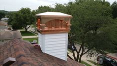 Copper Phoenician sits atop cornice trim enhanced chase pan.