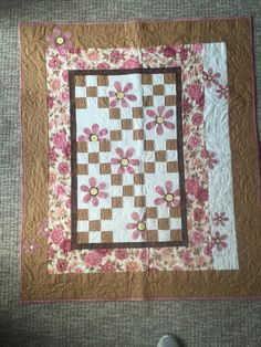 A personal favorite from my Etsy shop https://www.etsy.com/listing/398464007/baby-or-lap-quilt-with-pink-daisys