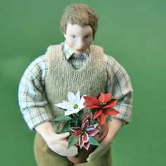 Miniature poinsettias made from paper. Make them as potted plants or for seasonal miniature flower arrangements. Tiny pots of poinsettias look great on full sized trees!