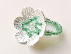 Ariane Hartmann Ring: Im Wort - Pusteblume, 2012 Green agate, 935 Ag, red silke thread
