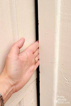 Installing weatherstripping on a garage door