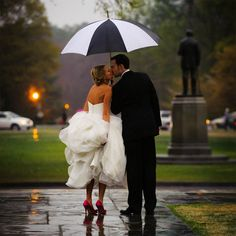 Gather your gown to keep it dry and show off your wedding shoes.