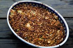 Apple Crisp ~ Crunchy, crispy apple crisp recipe.  Baked sliced tart apples topped with a streusel oat topping, with plenty of brown sugar, butter, and cinnamon. ~ SimplyRecipes.com