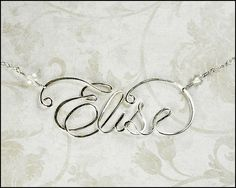 With baby girls name!? Sterling Silver Calligraphy Script Name Necklace, Personalized 18 Inch With Handmade Clasp. $49.97, via Etsy.