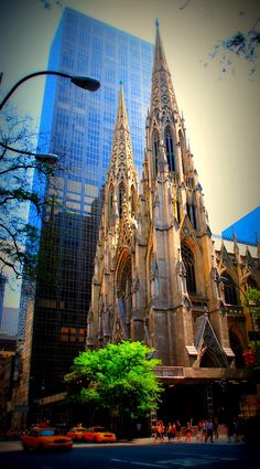 The gorgeous Saint Patrick's Cathedral, NYC, backed by a sky-scraper. #WeHeartNYC #WeWork
