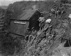 WW1, Battle of the Somme. Bandsmen of 12th Royal Scots outside their hut in Happy Valley (near Albert) July 12th, 1916. ©IWM