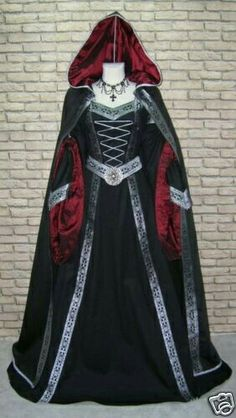 Beautiful regal black, red, and silver medieval dress with cape and hood.