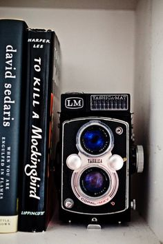 use vintage cameras as bookends- so cute! Doing this and I was able to pick one up for a few bucks at an estate sale.