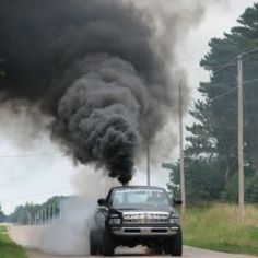 rolling coal enthusiasts jimmy their rigs to sew out black clouds