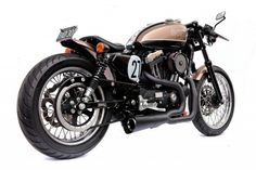 Australian custom motorcycle builder Deus introduced their latest model based on a 2007-model Harley Sportster. The 21- and 16-inch wheels have been replaced by 19-and 18-inch ones, it aims to improve the visual balance of the bike, and the rear sub frame has also been fabricated with fender and seat unit giving the bike an overall shorter and more muscular stance.