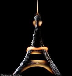 Eiffel Tower photograph by Stanislav Aristov.  One of an incredible series of photographs sculpted with spent and burning matches!