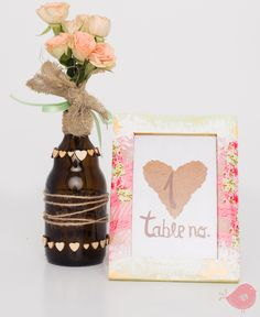 table number with heart woods decorated bottle