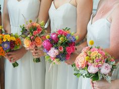 Bridesmaid bouquets with Billy balls, succulents and brights