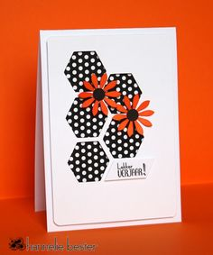 handmade birthday card from the desert diva: Happy birthday ... CAS(E) this sketch! #37 ... five-hexagon grouping of hexagons ... black paper with white polka dots ,,, red die cut daisies on top ... sentiment written in Africaans ... great card!!
