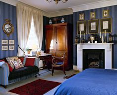 Blue striped wallpaper is nice, not sure about curtains etc.  A bit too much furniture.