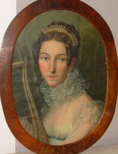here the diadem is directly behind those front curls--not as far back--usually it's behind the next bit of hair, just in front of the bun or wreath of braid.