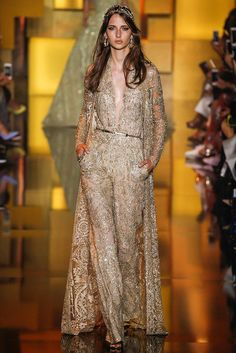 Deep Gold Laced V-neck Jumpsuit Witch Metallic Belt and Matching Separate Coat | http://brideandbreakfast.ph/2015/07/17/elie-saab-haute-couture-fw-2015/#more-57431 http://brideandbreakfast.ph/2015/07/17/elie-saab-haute-couture-fw-2015/#more-5743 | Designer: Elie Saab