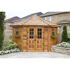 Would be cool to have the two wood garden sheds...the larger for living, cooking, the smaller for the bedroom.