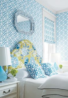 Beach house...blue, white, chartreuse, large print bold floral upholstered headboard, geometric fabric, wallpaper, stencil