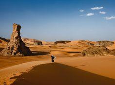 "Tuareg, Algeria    Photograph by Brent Stirton, National Geographic:    ""Evening winds stir the robes of a Tuareg striding across Algeria's Tassili-n-Ajjer."""