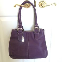 "Tignanello purple leather handbag NWOT Leather handbag 9"" drop handles, magnetic closure with zippered interior pocket and 2 slot interior pockets. Perfect condition non smoking home. Tignanello Bags"