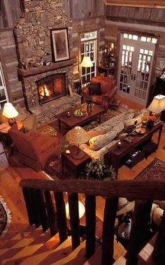 Stacked Stone fireplace with rustic beam mantel