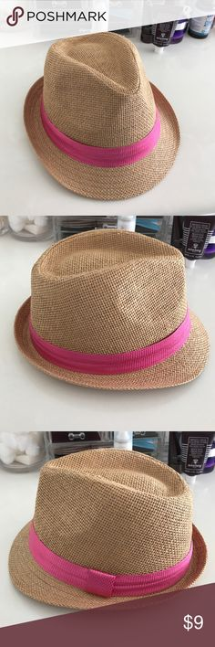 NEW Forever21 Straw Fedora with Pink Ribbon 🎀 This is a brand-new never worn fedora I got from forever 21. It is new but I cut the tags off. It is woven with a straw like material and has a pink fuchsia ribbon around it. It doesn't have a size on it it does say 57 CM I'm not sure if that centimeters or not. But I wear a size small for a 🎩 and it fits me just fine. No trades please. Reasonable offers only. Thank you for looking. Forever 21 Accessories Hats