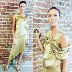 Model in NIKOLAKI Resort 2018 gold silk charmeuse bias-cut dress with asymmetrical hemline and draped neckline