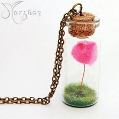 Lorax by Marzrian is a glass bottle pendant that contains a miniature pompom Lorax tree on a grass setting with a blue diamond shaped crystal.  These delicate necklaces are water resistant, however, please wear with care and do not wear in water or during physical activity.  Available on Etsy https://www.etsy.com/au/shop/Marzrian?section_id=16500140&ref=shopsection_leftnav_3